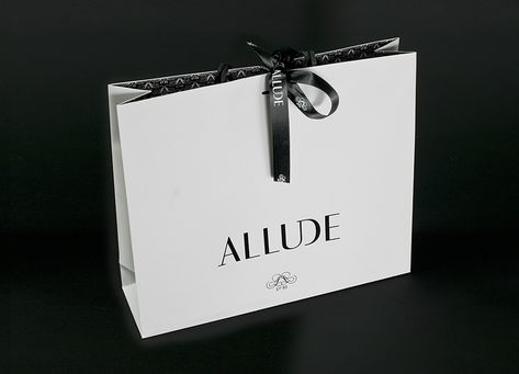 Allude Bag Printed on beautiful hammered material in double density black – the construction uses a cuff that folds back into the bag.