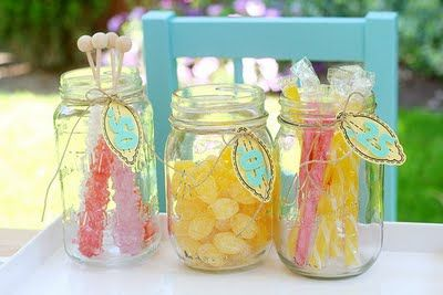 Pink and yellow candy in mason jars