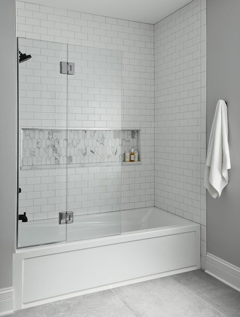 The kid's bathrooms are bright, clean spaces for them to enjoy with subtle textures introduced in the tiles and countertop. Shower Accent Tile, Glass Tile Shower, White Subway Tile Bathroom, Subway Tile Showers, Tile For Small Bathroom, Bathtub With Glass Door, Bathroom Tile Showers, Bathtubs For Small Bathrooms, Tile Bathrooms