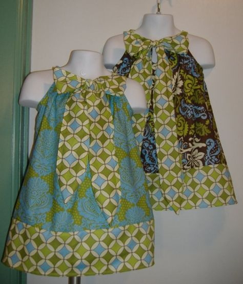 Your traditional pillowcase dress in the front but comes together in the back to form a keyhole before tying in a large bow.