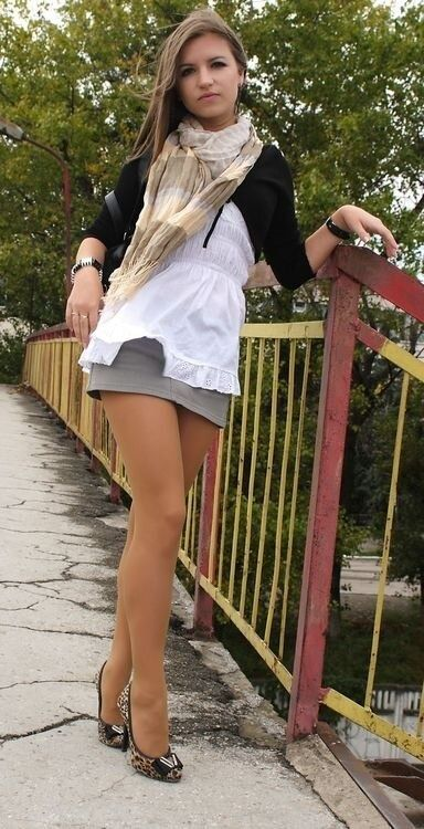 Scarf, cardigan, white top and grey skirt with nude pantyhose and leopard print heels