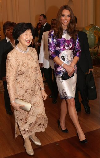 Kate, Duchess of Cambridge, walks with the president of Singapore's wife, Mary Tan, at the Istana on Sept. 11, 2012, in Singapore.