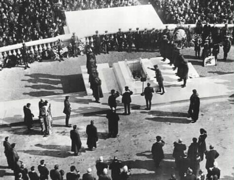 The Unknown Soldier is lowered into the tomb, November 11, 1921.