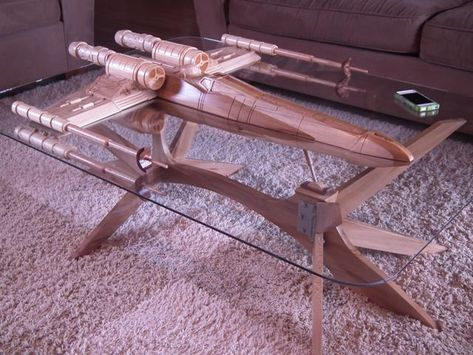 X-Wing Coffee Table from Barry Shields.  It took 6 months to carve the table.  He'll make one for you if you fork over $5500.