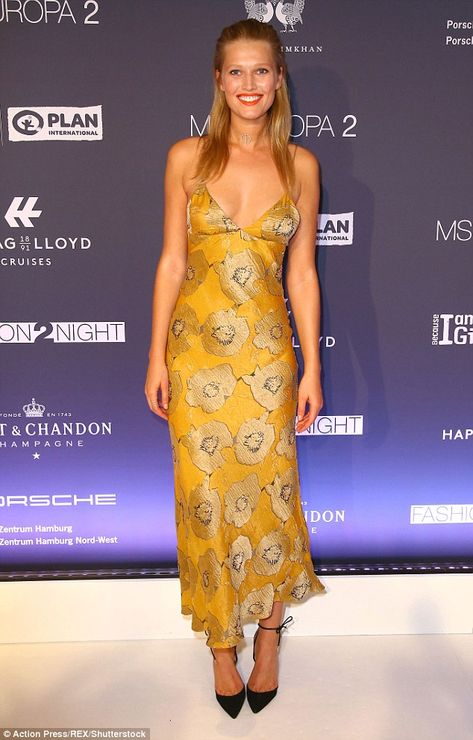 Chic and cheerful: It came as no surprise to see Toni Garrn looked effortlessly glamorous as she attended the Fashion2Night event in Hamburg on Tuesday