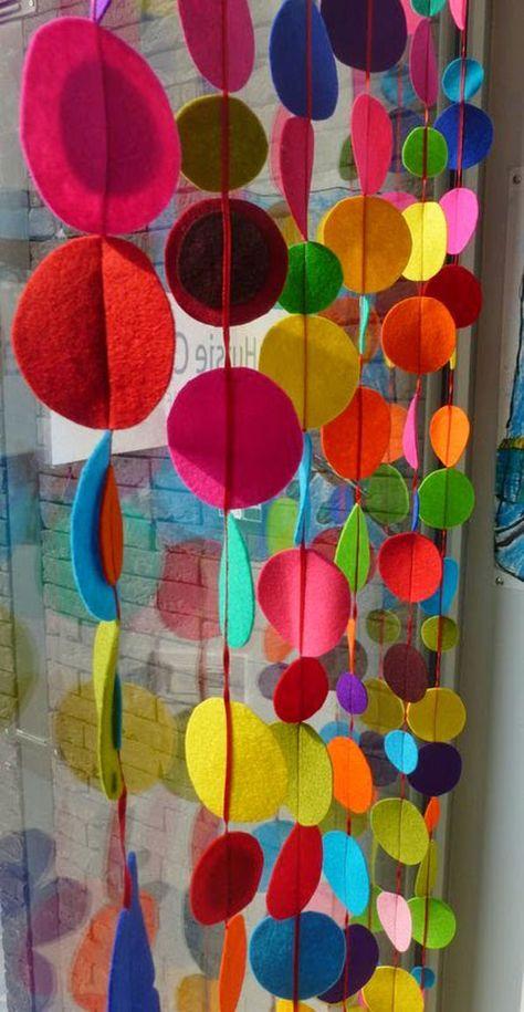 Felt curtain in rainbow colors.