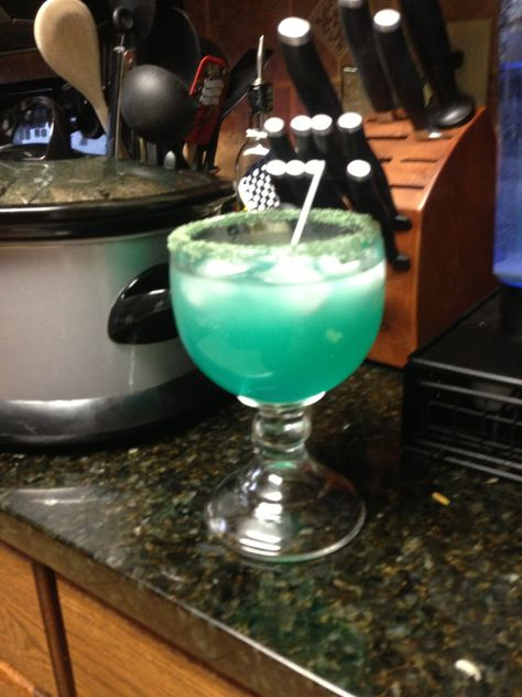 Shandyrita...inspired by Buffalo Wild Wings drink. 1 oz blue curaçao, 1 oz tequila, 4 oz margarita mix, mix with ice in shaker or blend in blender with ice, top off with Leinenkugel's summer shandy. Don't forget to rub a lime across edge of glass and dip on margarita salt;) I just put lime juice in a bowl and let the rim of my glass sit there while I mix everything:)