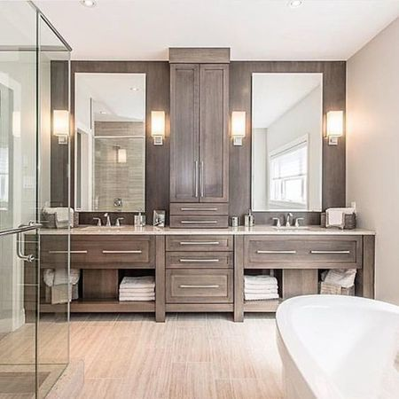 Love the vanity, upper cabinets and how wood continues behind mirrors so that upper cabinet doesn't stand out as out of place like in other examples like this.  Like the sconces.  A bit more traditional than other examples.