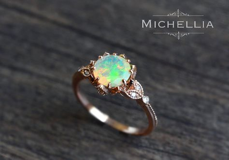 「Evanthe」  Note: This listing sells the opal ring ONLY; For the matching leaf band shown in the last two pictures, please purchase separately from the link below: https://www.etsy.com/listing/398187745/14k18k-leaf-diamond-wedding-band  By popular request, I have made the opal version of this original design. Similar to the moonstone floral ring, this vintage-inspired opal engagement ring combines the elements of Art Nouveau with an elegant modern touch. With its brilliant display of color…