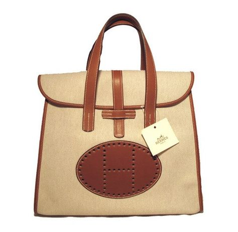 Hermes Rare Canvas Toile   Barenia Leather Tote Bag - This is an Hermes  Canvas   Barenia Leather tote bag. Woven beige Toile canvas exterior with  tan ... 6dd2e566207c7