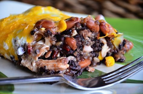 Delicious to combine black rice, pinto beans, and chicken into one-pot meal. Perfect for a Mexican entertaining night! ReluctantEntertainer.com