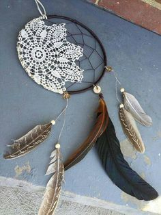 This dreamcatcher is sure to add the perfect touch to any occasion or sacred space. The center features a vintage cream doily halfway wrapped around the suede wrapped hoop so a little of the web is visible. The bottom is full of gorgeous feathers. Embellished with wood beads, crystal beads