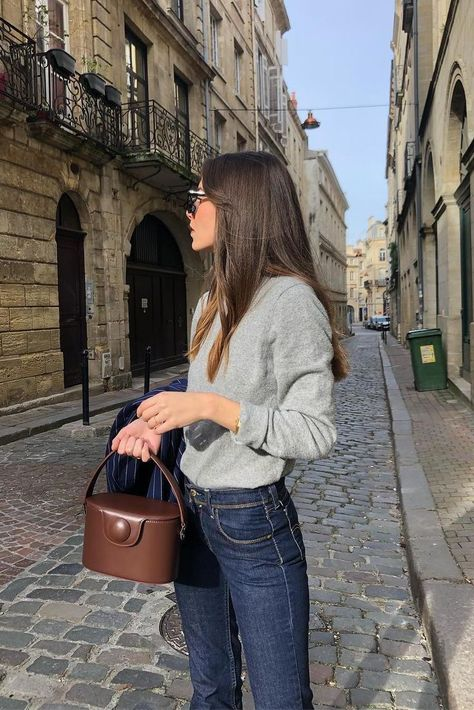 Simple Spring Denim Outfit, grey sweater dark blue jeans and brown bucket bag