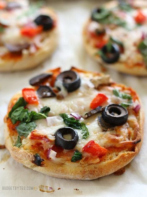 Freezer Ready Mini Pizzas are an easy and inexpensive snack to keep on hand in your freezer. #pizza #freezermeals #freezercooking #pizzarecipes #easyrecipes #easydinner #dinnerrecipes