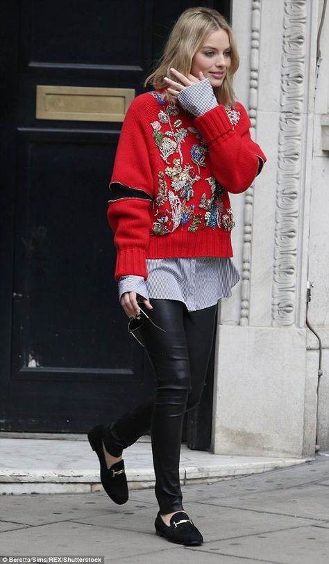 Superb style: Margot styled her statement jumper with black leather leggings and a pair of black suede loafers, which featured a gold bar across the foot