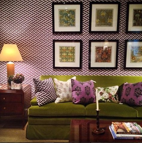 """Alexa Hampton was the talk of the market: seeing her work is one of the """"don't miss"""" moments. The rooms showing her collection for Hickory Chair are colorful, layered with pattern, texture, accessories, artwork and, of course, really lovely furniture pieces like this bright olive green velvet Macdonald sofa. Classic good lines and construction, done up in a showstopping way - bravo! Hickory Chair, 330 North Hamilton."""