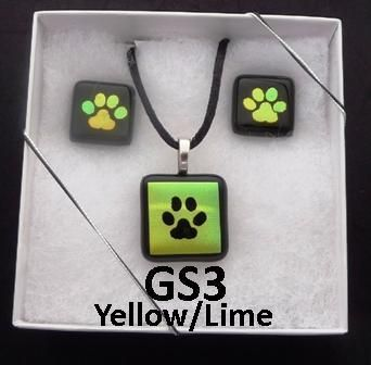 "Paw Print Dichroic Glass Pendant and Earring Gift Set. Pendant measures approximately 1 inch with silver plated bail and 18"" or 20"" black satin neck cord. Earrings are approximately 3/4 inch black and have surgical steel posts"