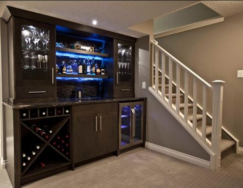 In home bar with light up shelves... This would be an awesome repurpose diy out of am old entertainment unit. Add a shelf or two in the middle and paint it all black- LOVE! !! ^-^