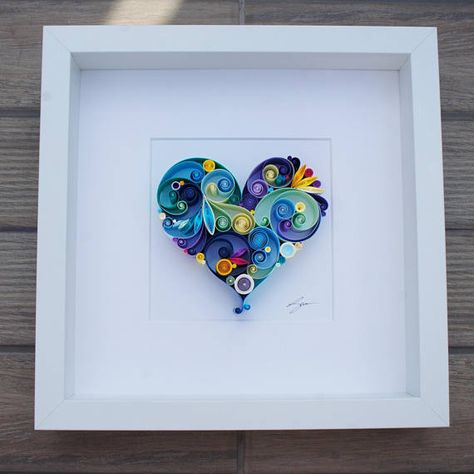 This quilled paper artwork named Love is All Around is handmade from colourful strips of paper. Its placed in a white deep frame, frame size is 25x25cm (approx. 9,5x9,5 inches) Size of the heart is approx. 11x11cm (4,3x4,3 inches) This piece of art is made to order. Please allow 2 weeks