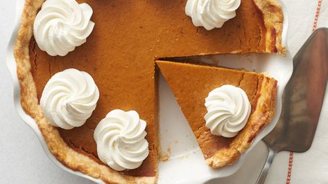 When it comes to Thanksgiving, our eyes go right to the dessert table, searching for homemade Pumpkin Pie. With a flaky crust, smooth pumpkin filling and sweetened whipped cream, what's not to love about Pumpkin Pie? This is the best Pumpkin Pie recipe we've ever made, thanks to its incredible flavor profile and simple instructions. If there are leftovers–which are usually hard to come by–we'll even have Pumpkin Pie for breakfast!