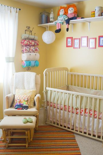 Cute way to store baby blankets so you can see them in a nursery - I've seen this for towels, but love it for pretty blankets
