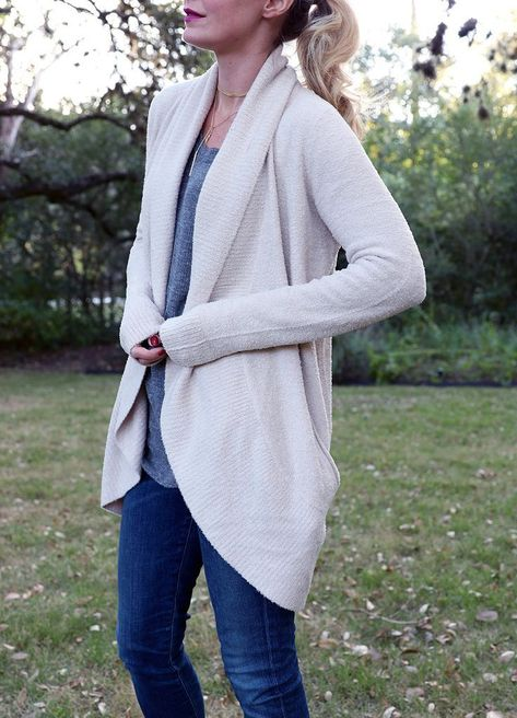 my favorite cozy sweater of the season is this white barefoot dreams cardigan from nordstrom