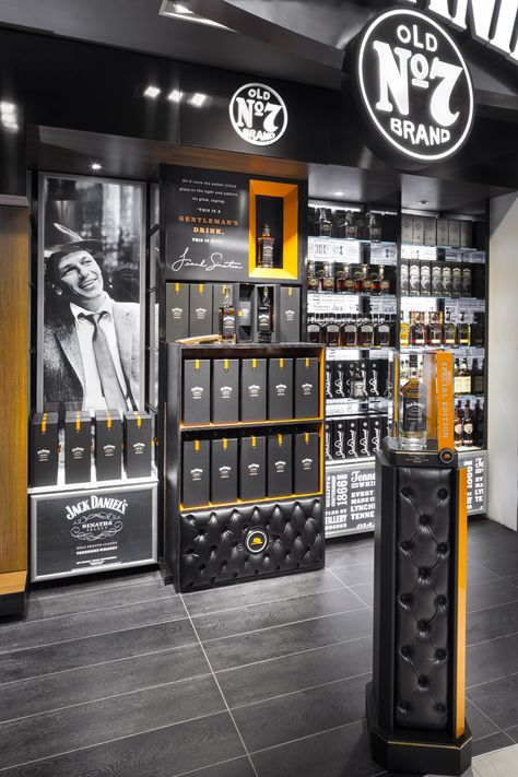 Jack Daniel's/Frank Sinatra duty free store. More here: http://vmsd.com/content/come-fly-me Photography: Mark Steele Photography, Columbus, Ohio