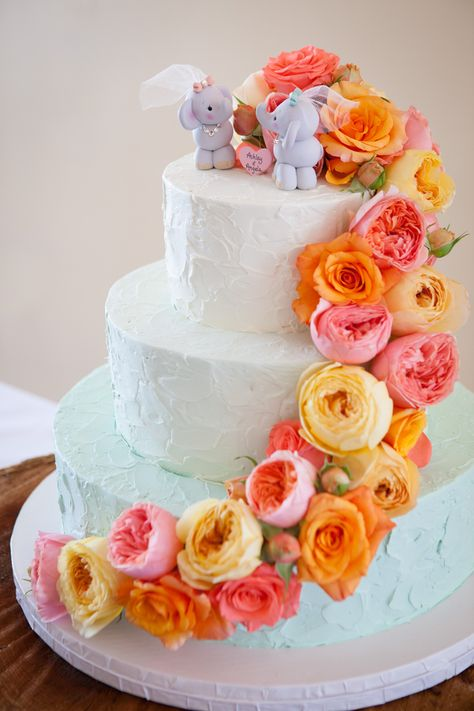 Adorable elephant cake topper on a beautiful floral wedding cake | Offbeat Bride