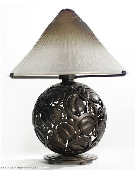 An Art Deco patinated wrought iron table lamp by Edgar Brandt with glass shade by Daum, France circa 1925.