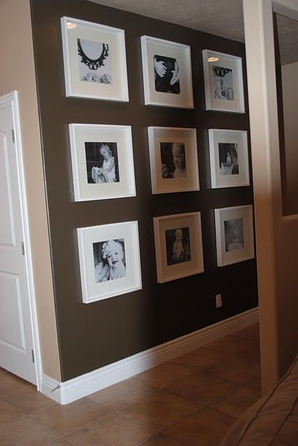 use Michaels $5 12×12 frames ( I think they call them record album frames). Black and white photo's, and you could even cut 12×12 scrapbook paper for the mat effects. @ Home DIY Remodeling.    Love this idea for a hallway