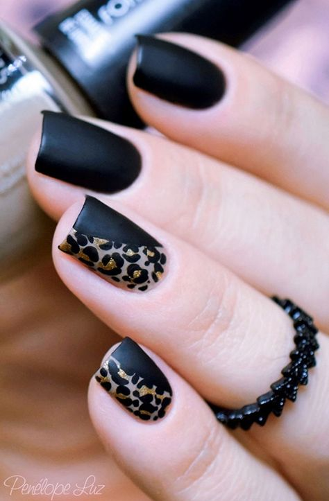 Black matted leopard nail art design. the matte colors are absolutely gorgeous and they help highlight the gold and gray leopard prints on top.