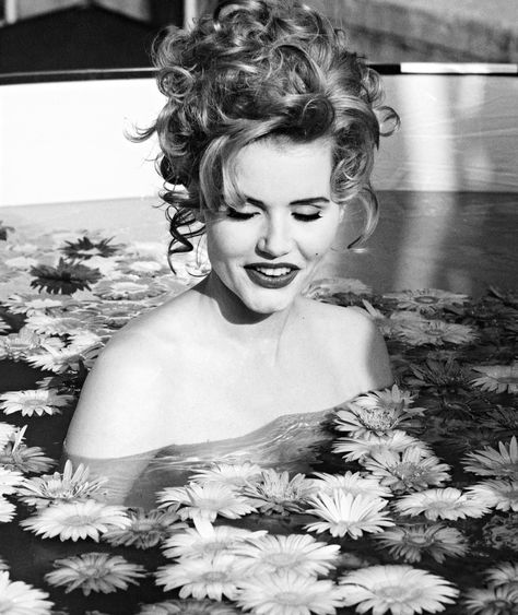 """YSL Muse Marina Schiano's Scrapbook of Fame: 1992, Geena Davis """"We were filming her for Vanity Fair. This picture was never published, obviously. She went in the pool, and I took her picture. No, she's not naked."""""""