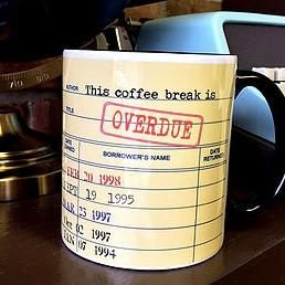 This coffee break is overdue! Mug designed with old style yellow library card stamped overdue. Dishwasher safe