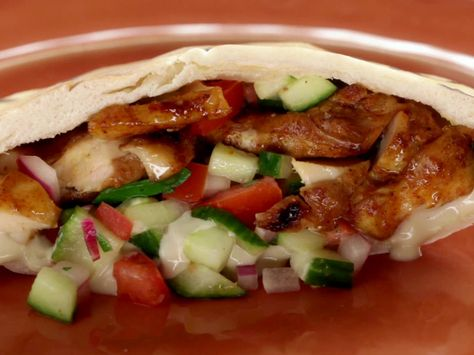 Get this all-star, easy-to-follow Chicken Shawarma with Tomato Cucumber Relish and Tahini Sauce recipe from Jeff Mauro.
