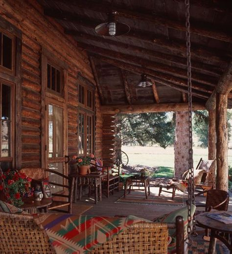 Restful and relaxing rustic porch in this Montana log home created by Miller Architects, Montana