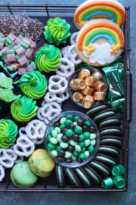 """Treat your Leprechauns to a festive and fun St. Patrick's Sweets Charcuterie! Let's start with a """"pot of gold"""" filled with chocolate coins, leprechaun humor, a hint of rainbow goodness and lots of green candy and homemade bakery treats!"""