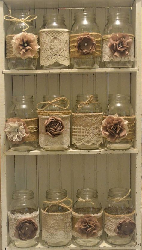 For sale is 12 handmade mason jar sleeves. Burlap adorned with ivory/natural color lace and handmade flowers are perfect for a rustic wedding! Colors of flowers-brown Mason jars are not included. These will fit Ball quart regular mouth. I can do other size sleeves. Please do not