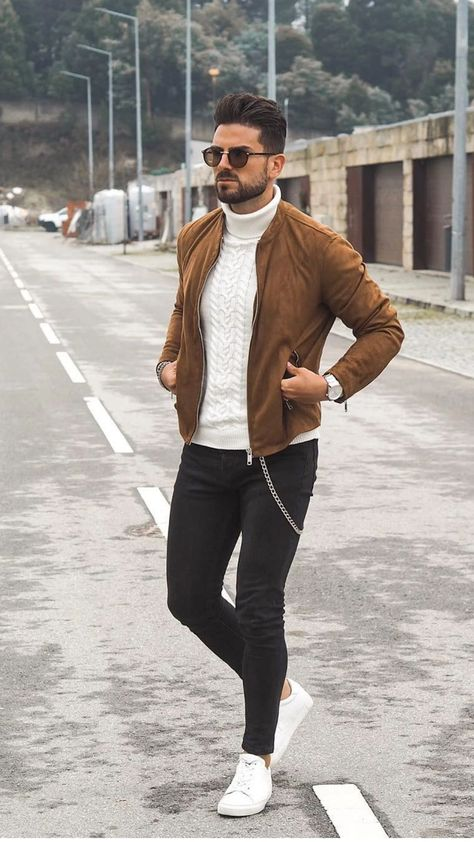 Fall combo inspiration with a white cable knit turtleneck brown suede jacket black framed sunglasses black slim cut denim silver watch no show socks white sneakers -