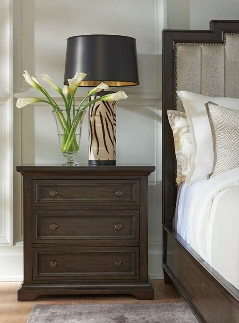 The Crestwood Nightstand shows that design can be both sophisticated and casual. Barclay Butera strikes a skillful balance between the past and the present with this exceptionally designed nightstand. The traditional shapes and deep Wilshire finish give your bedroom a warm and inviting feel. The black nickel hardware with Greek key pattern adds a touch of modern glitz.