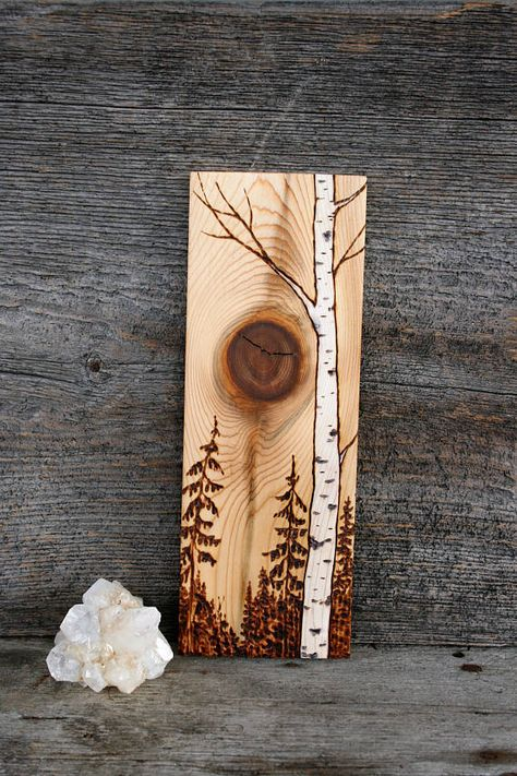 A beautiful scene with a lone birch tree has been burnt into a lovely and unique piece of salvaged wood. Finished in walnut oil to enchance the wonderful grain of the wood. The piece measures almost 9 3/4 inches tall by 3 1/2 inches wide on 3/4 inch thick solid white cedar wood.