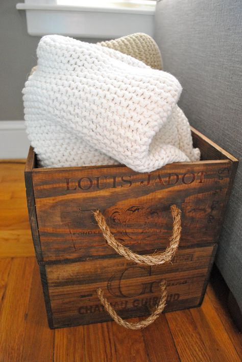 DIY Wine Crates for holding blankets.