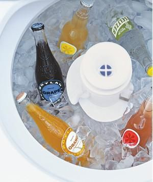 Fill the tub with ice and extra bottles of beer and wine so you don't have to empty the refrigerator to make room for party supplies. Bonus: The melted ice neatly drains right through the machine's holes.