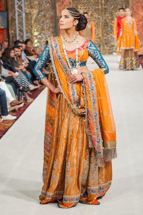 Turmeric and sea blue lehenga for the perfect glowing bride. Pair up with some Gold jewelry to finish the look.
