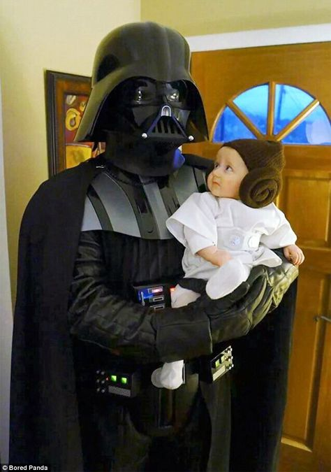 This Darth Vadar carried an adorable Princess Leia in his arms