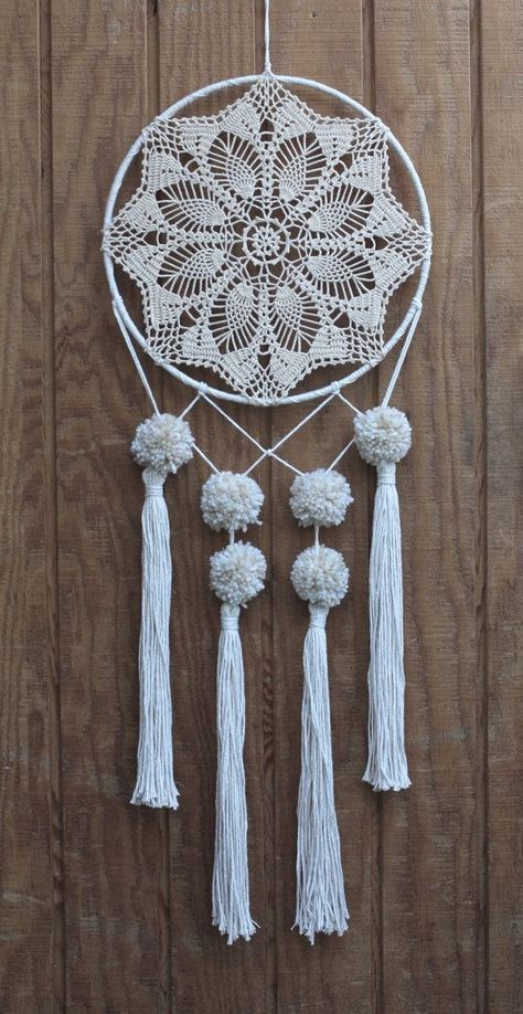 12 neutral tone, crocheted, lace dreamcatcher made with unbleached, hand-knotted cotton, salvaged materials and decorated with pom poms & tassels. by marjorie