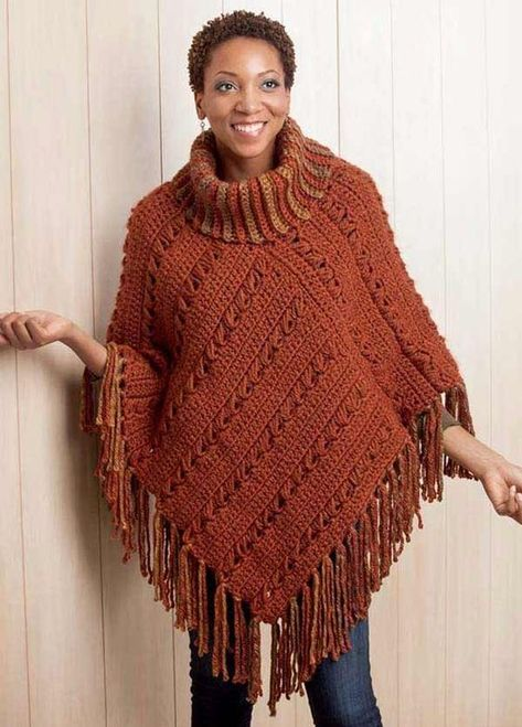 Boho Chic Crochet Ponchos - Lush fringe and rich colors revive the poncho in the seven fabulous designs in Boho Chic Crochet Ponchos from Leisure Arts. Styles range from dressy to casual, and they're all easy to crochet. Offset Granny has a striped yoke, large squares set on point, and deep fringe. Others include Silken Stripes in rich metallic yarn, Plush Topper with cross-body fringe, Lacy, Broomstick Lace with a cowl neckline and blended fringe, Reverse Motifs in black and white with jumb...