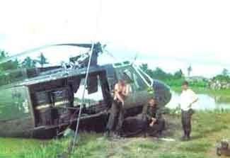 Agent Orange, White and Blue Defoliant was spayed all over South Vietnam. This Huey is carrying White. There are many links to explore by clicking on this photo.