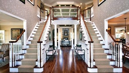 A double staircase makes a memorable entry to the Harding Plan a
