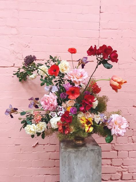 exposed brick wall, flowers, pink