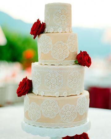 Edible lace on a white-chocolate cake filled with chocolate ganache